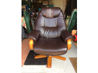 Recliner Arm Chair covered in brown simulated leather.