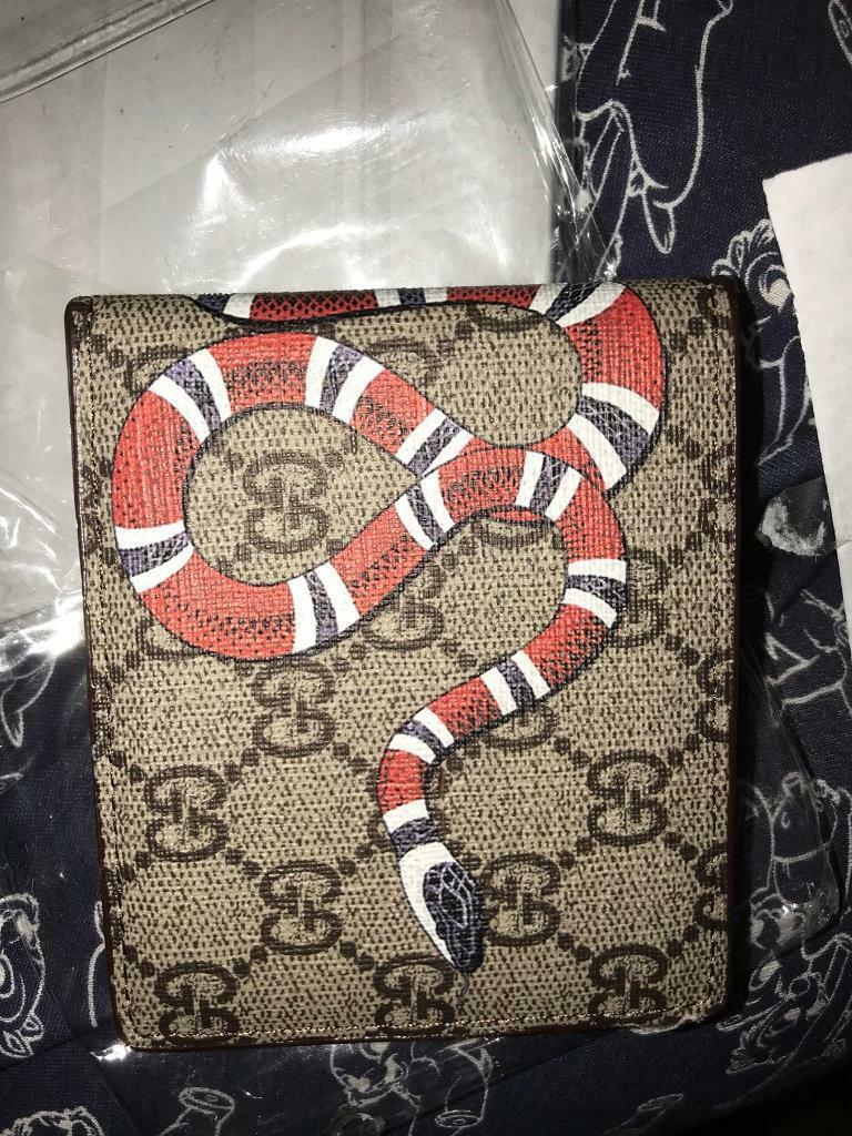 2d369f8b118 Gucci Wallet with snake print