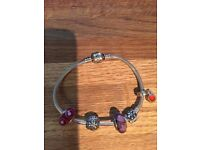 Genuine Pandora bracelet with 4 charms