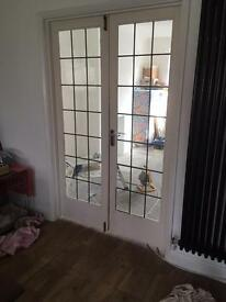 Hardwood interior French doors with leaded glass