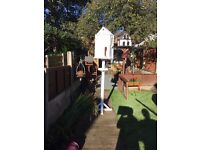 delightfull free standing bird feeder and nesting boxes