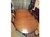 Twin Pedestal dining table, seats 6 along with 4 chairs and two carvers.
