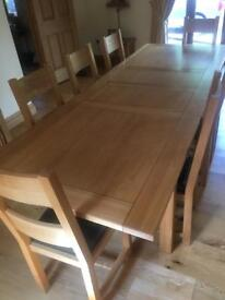 Solid oak table extending table and chairs x 8 leekes