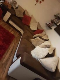 Brown and cream DFS sofa almost new with swivel chair and puffy included