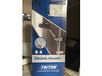 Triton Electric shower brand new £120