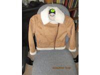 Jacket - girl's light brown sheepskin style 7-8 yrs.