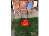 Flymo petrol lawn mower