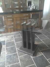 Glass top 4 seater table