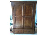 Beautiful wooden wardrobe with drawers