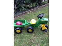 John Deere tractor with detachable trailer