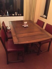 Antique Solid Oak extending dining table and 4 dining chairs .