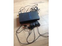 PS 2 console and controller