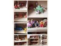 Dolls house + furniture sold separately.