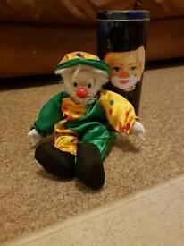 Clown doll on a tin