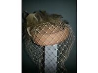 LADIES BROWN HAT WITH FEATHERS