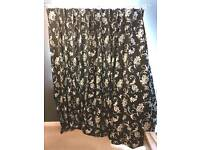 Pair Of black and white patterned curtains