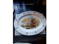 large oval serving platter with ships on