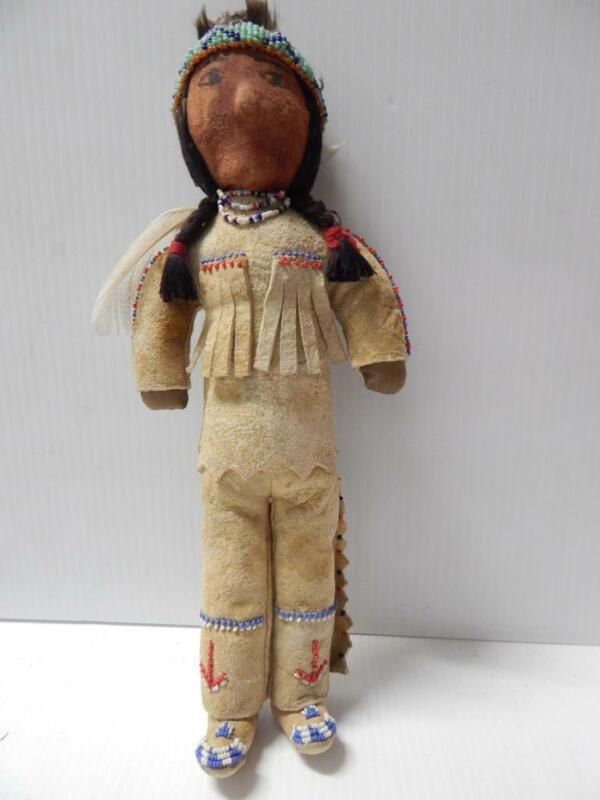 VINTAGE MONTANA FLATHEAD INDIAN MALE WARRIOR DOLL BEADED HIDE CLOTHING