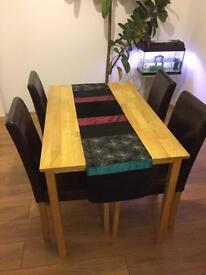 Solid oak dining table and four leather chairs