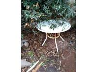 Outdoor table.. needs a coat of paint.. but would easily clean up for the summer