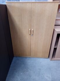 1240x955x450mm Low storage cupboard in oak with two doors.