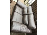 Two seater Brown leather sofa in very good condition