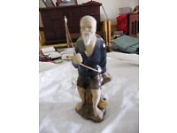 Oriental fisherman figurine
