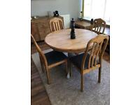 Round extending dining table with 4 dining chairs