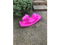 Kids outside rocking horse