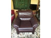 Brown leather arm chair with footstool