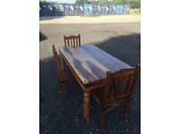 Stunning 5.5ft Indian Oak Table And 3 Chairs. Excellent Condition. Can Deliver.