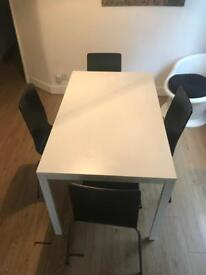 IKEA White Dining Table with Black Chairs