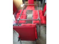 Glass Table and 6 Red Chairs