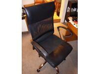 Black mesh back swivel chair with arms