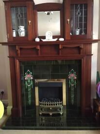 Mahogany fireplace surround.