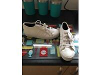 Junior white adidas trainers