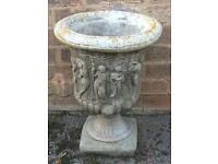 Further Reduced Two Concrete cherub urn planters