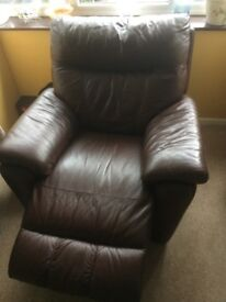 Brown Leather 3 piece suite. 2 recliner chairs and 1 three seater sofa also recliner on 2 seats