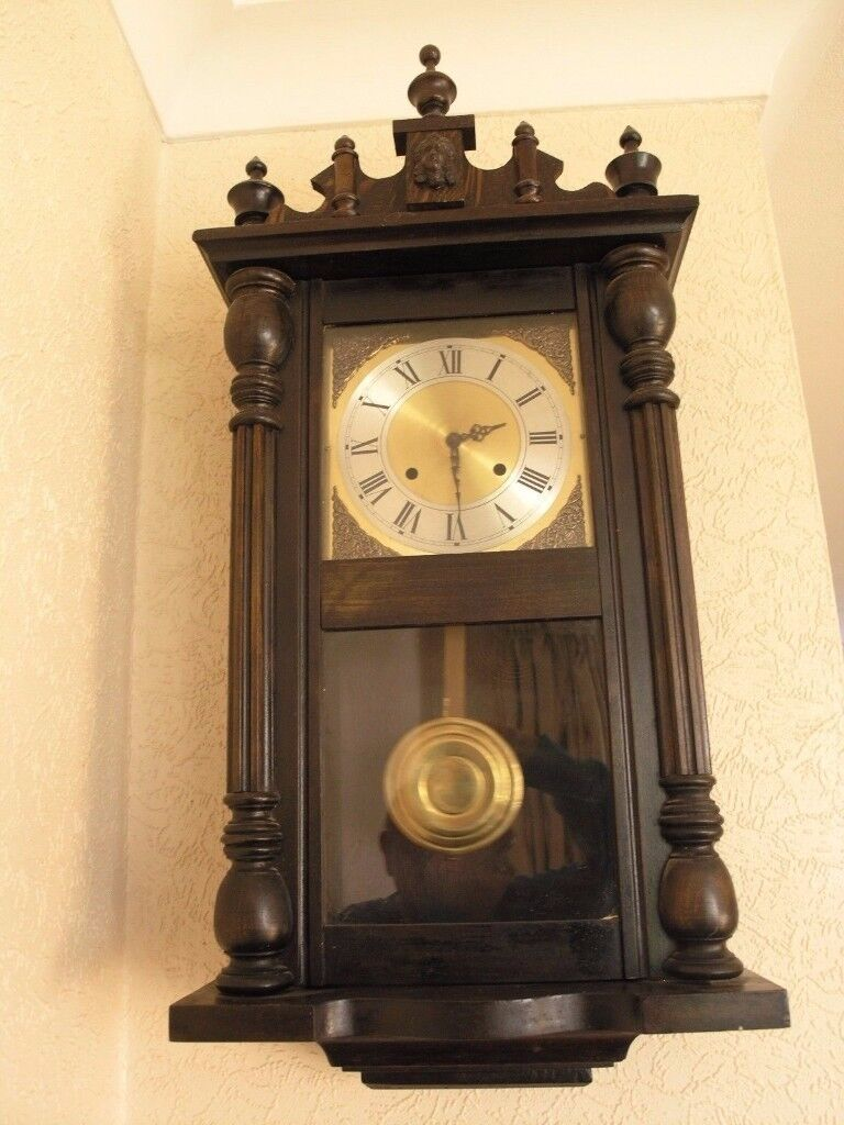 WOODEN CASED WALLCLOCK