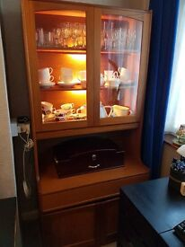 Dresser with glass doors and drawer in teak.