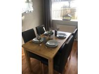 Solid wood Dining Table with 4 Black faux leather chairs