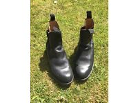 Black leather riding boots, ankle length, in good condition.