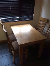 Solid oak kitchen dining table and four high back chairs