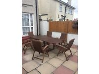 6 STRONG TEAK GARDEN CHAIRS WITH TABLE. CHAIRS £20 eac. Good condition