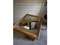 mirror in gold coloured wood frame