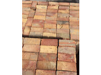 Driveway paving multi-coloured brick setts, reclaimed recycled from house demolition