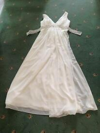 Brand new unworn unaltered Emily Fox wedding dress. Size 18 with lace up dress.