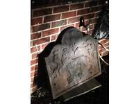 Antique Fire back cast iron of the laughing lion