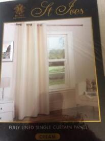 Brand new in packet cream curtains .