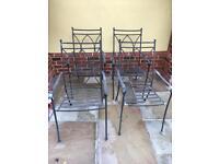 4 wrought iron garden chairs